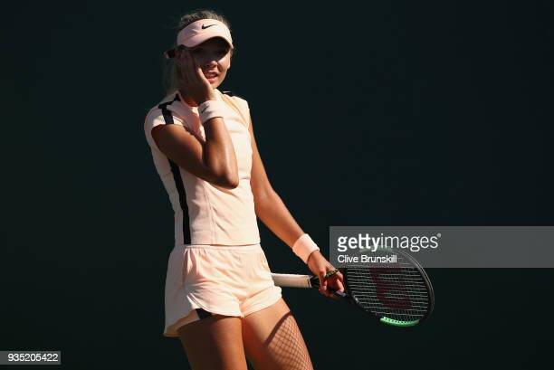 Katie Boulter of Great Britain shows her dejection during her final Qualifying round match against Carol Zhao of Canada during the Miami Open...