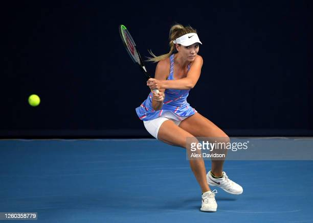 Katie Boulter of Union Jacks plays a backhand in her match against Emma Raducanu of British Bulldogs during Day One of the St James's Place Battle Of...