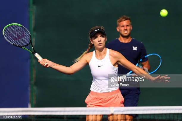 Katie Boulter of Union Jacks returns a forehand with doubles partner Lloyd Glasspool to Liam Broady and Harriet Dart of British Bulldogs during day...