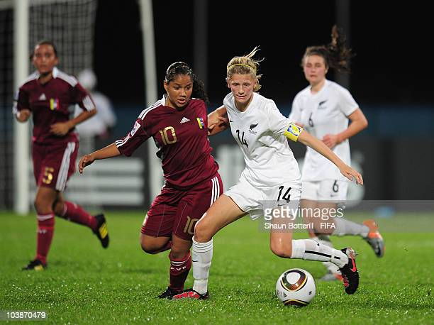 Katie Bowen of New Zealand is challenged by Marialba Zambrano of Venezuela during the FIFA U17 Women's World Cup Group C match between New Zealand...