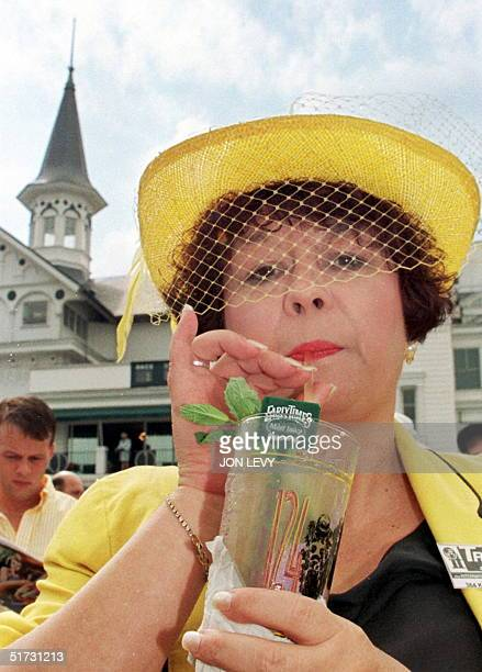 Katie Bradford of Kentucky enjoys a ice cool mint julep a traditional Kentuck Derby drink 02 May in the paddock area at Churchill Down in Louisville...