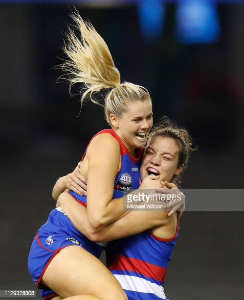 Katie Brennan and Ellie Blackburn of the Bulldogs celebrate during the 2019 NAB AFLW Round 06 match between the Western Bulldogs and the Melbourne...