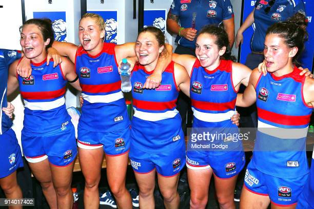 Katie Brennan celebrates the win with Ellie Blackburn and Kirsty Lamb of the Bulldogs during the round one AFLW match between the Western Bulldogs...