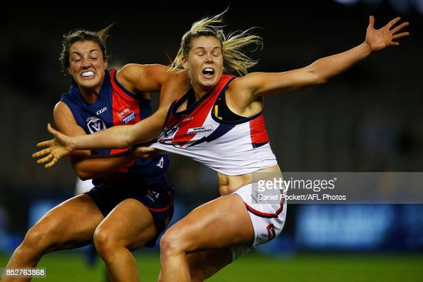 Katie Brennan of Darebin and Kerryn Harrington of Diamond Creek contest the ball during the VFL Women's Grand Final match between Diamond Creek and...