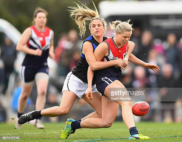 Katie Brennan of Darebin kicks whilst being tackled by Bailey Hunt of Melbourne Uni during the VFL Women's Grand Final between Darebin v Melbourne...