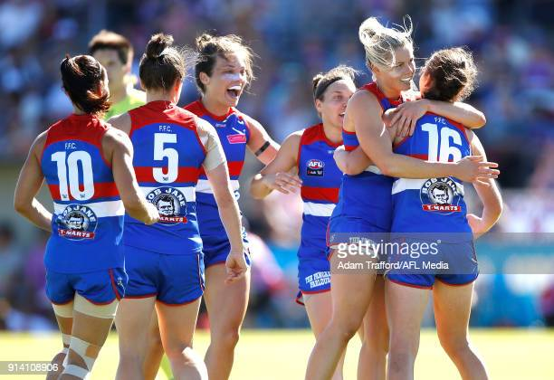 Katie Brennan of the Bulldogs celebrates a goal with teammates during the 2018 AFLW Round 01 match between the Western Bulldogs and the Fremantle...