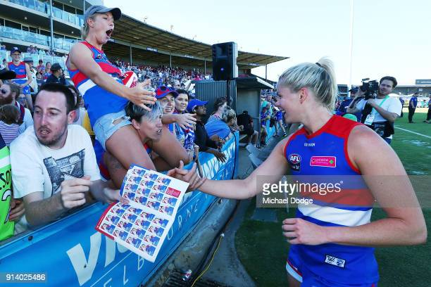 Katie Brennan of the Bulldogs celebrates the win with fans during the round one AFLW match between the Western Bulldogs and the Fremantle Dockers at...