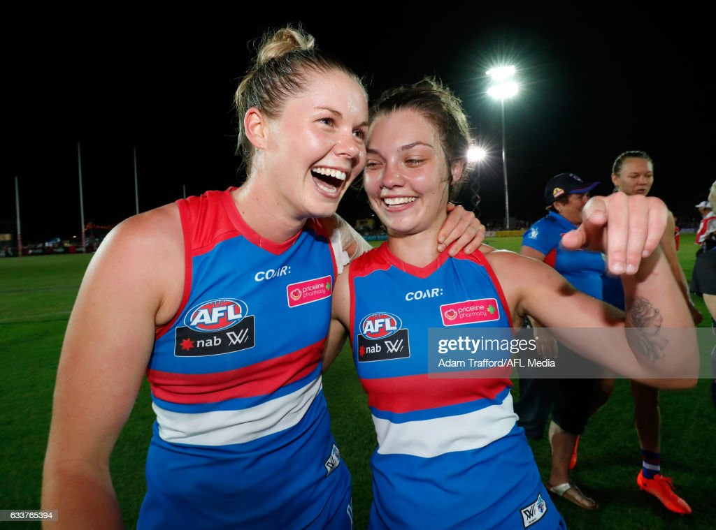 Katie Brennan of the Bulldogs (left) celebrates with Ellie Blackburn of the Bulldogs during the 2017 AFLW Round 01 match between the Western Bulldogs and the Fremantle Dockers at VU Whitten Oval on February 4, 2017 in Melbourne, Australia.