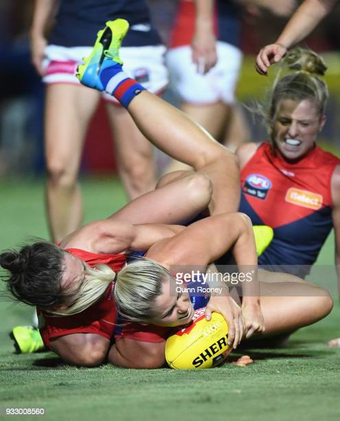 Katie Brennan of the Bulldogs is tackled by Harriet Cordner of the Demons during the round seven AFLW match between the Western Bulldogs and the...