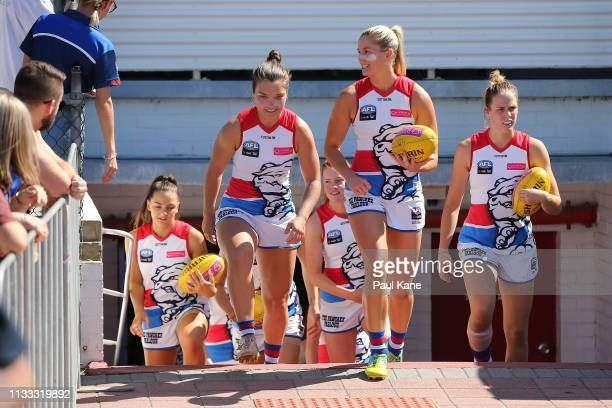 Katie Brennan of the Bulldogs leads the team onto the field during the round five AFLW match between the Fremantle Dockers and the Western Bulldogs...
