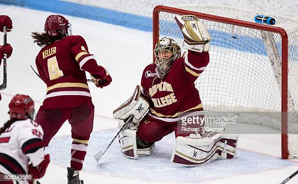 Katie Burt of the Boston College Eagles makes a glove save against the Harvard Crimson during NCAA woman's hockey at the Walter Brown Arena during...