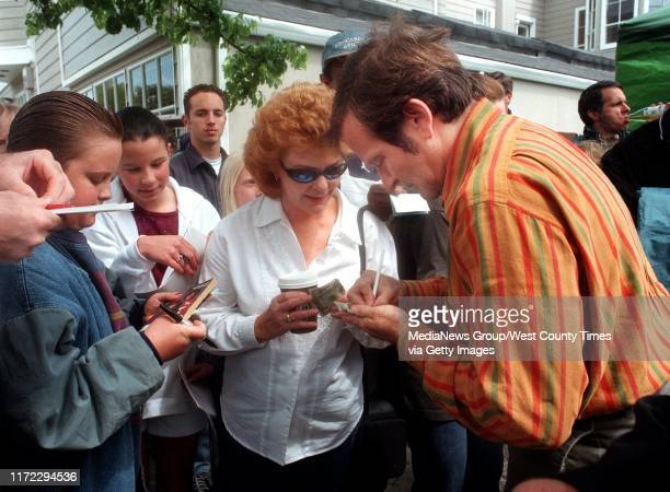 Katie Cembellin of Richmond gets an autograph from Robin Williams during a break in filming of Patch Adams in Point Richmond on Tuesday April 14 1998...
