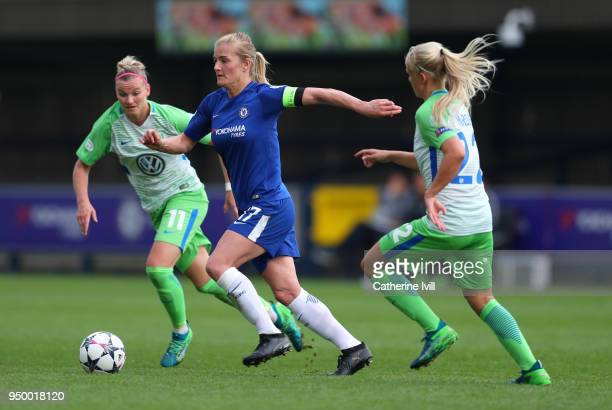Katie Chapman of Chelsea in action with Alexandra Popp and Pernille Harder of Wolfsburg during the UEFA Womens Champions League SemiFinal First Leg...