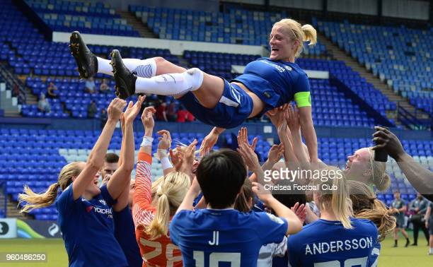 Katie Chapman of Chelsea is thrown in the air by her team mates during a WSL match between Liverpool Ladies and Chelsea Ladies on May 20, 2018 in...