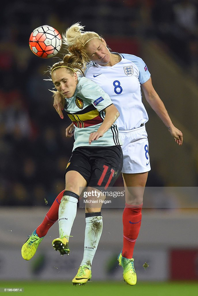 Katie Chapman of England wins a header over Janice Cayman during the UEFA Women's European Qualifer between England and Belgium at The New York Stadium on April 8, 2016 in Rotherham, England.