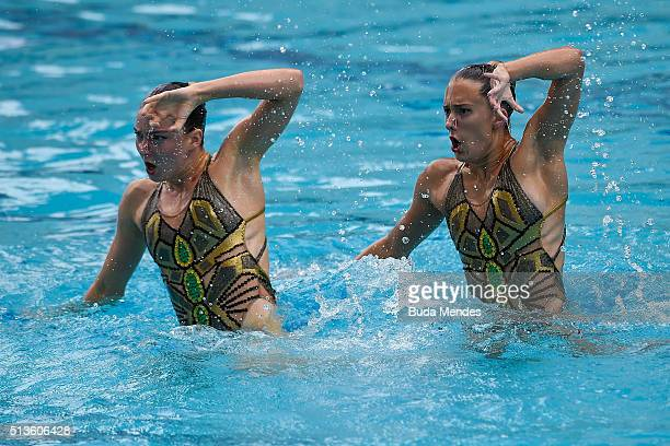 Katie Clark and Olivia Federici of Great Britain compete in the Duets Free Routine First Round during the FINA Olympic Games Synchronised Swimming...