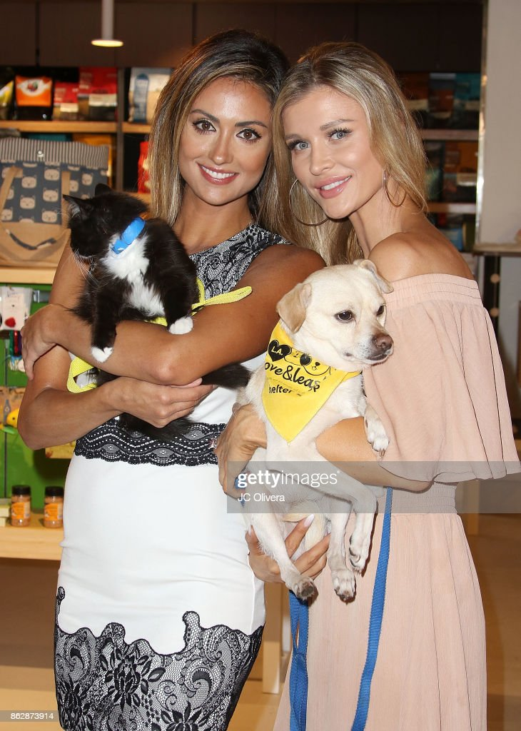 Katie Cleary (L) and Joanna Krupa attend a press conference celebrating Calfornia Governor Jerry Brown signing California assembly Bill 485: The Pet Rescue and Adoption Act banning the sales of dogs, cats, and rabbits in retail stores at Healthy Spot on October 18, 2017 in Los Angeles, California.