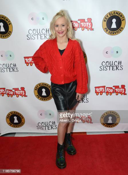 Katie Couch attends The Couch Sisters 1st Annual Toys For Tots Toy Drive held onNovember 20 2019 in Glendale California