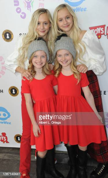 Katie Couch, Kameron Crouch, Mia Allan and Ella Allan attend the 2nd Annual Toys For Tots Toy Drive held at The Industry Loft Space on November 21,...