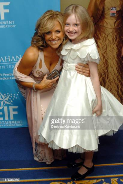 Katie Couric and Dakota Fanning during Entertainment Industry Foundation's Colon Cancer Benefit on the QM2 Red Carpet at Queen Mary 2 in New York...