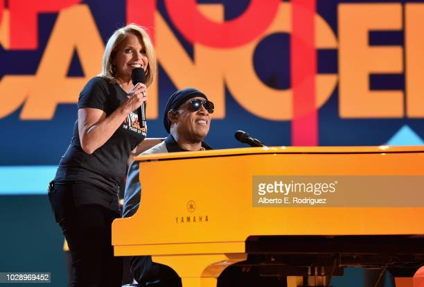 Katie Couric and Stevie Wonder perform onstage at the sixth biennial Stand Up To Cancer telecast at the Barkar Hangar on Friday September 7 2018 in...
