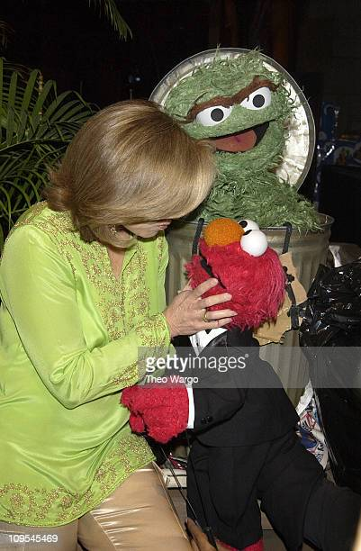 Katie Couric with Sesame Street's Oscar the Grouch and Elmo