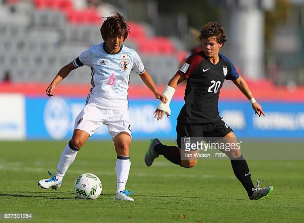 Katie Cousins of United States tries to tackle Rin Sumida of Japan during the FIFA U20 Women's World Cup Third Place Play Off match between USA and...
