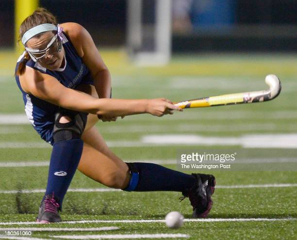 Katie Cummings sends the ball down field as the South County Stallions defeat the Oakton Cougars 2 1 in girls field hockey at Oakton High School in...