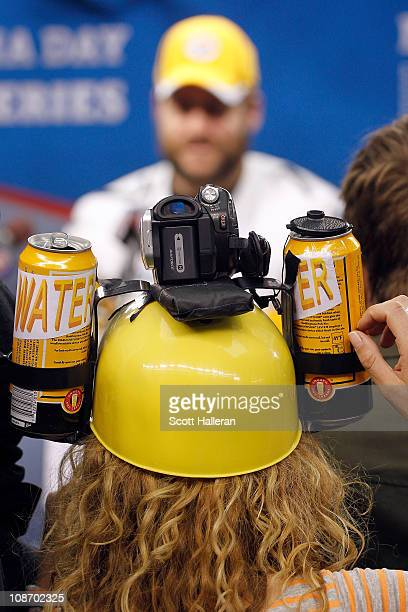 Katie Daryl of HDNet watches Ben Roethlisberger of the Pittsburgh Steelers on during Super Bowl XLV Media Day ahead of Super Bowl XLV at Cowboys...
