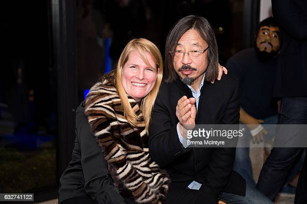 Katie De Tilly and artist Huang Rui attend 'Art Los Angeles Contemporary host committee members and collectors Joel Lubin and wife Marija Karan host...