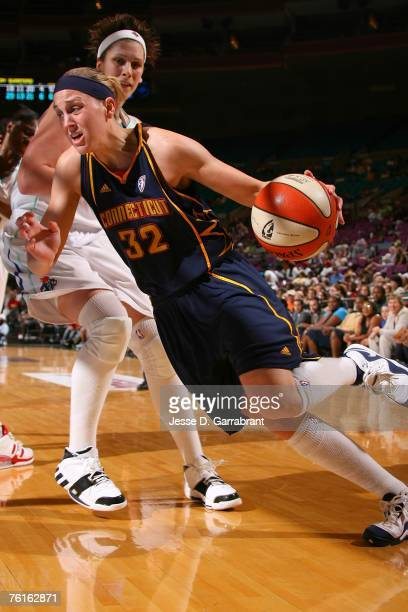 Katie Douglas of the Connecticut Sun drives against Janel McCarville of the New York Liberty at Madison Square Garden August 17 2007 in New York City...