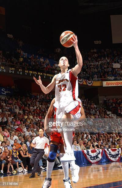 Katie Douglas of the Connecticut Sun goes to the basket against the Charlotte Sting on June 3 2006 at Mohegan Sun Arena in Uncasville Connecticut...