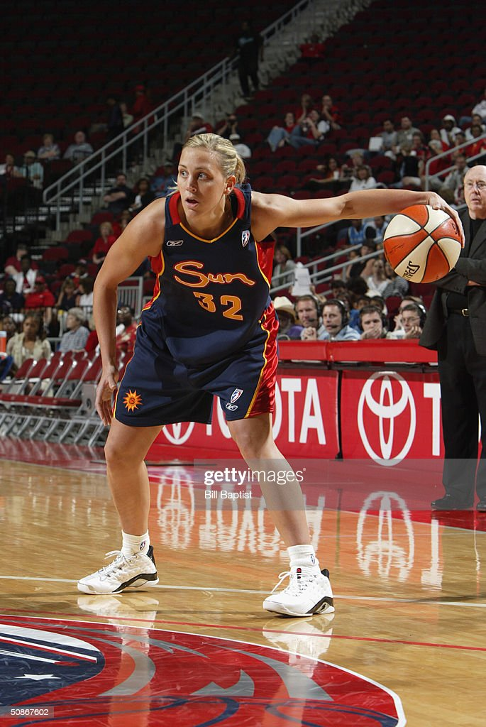 Katie Douglas #32 of the Connecticut Sun looks to make a play on the dribble against the Houston Comets during the preseason game at Toyota Center on May 11, 2004 in Houston, Texas. The Comets won 84-71.