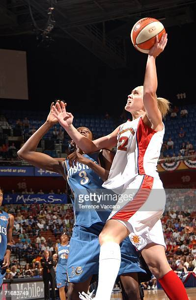 Katie Douglas of the Connecticut Sun shoots against Delisha MiltonJones of the Washington Mystics in game two of the Eastern Conference Semifinals...