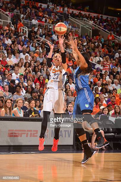 Katie Douglas of the Eastern Conference AllStars shoots against Maya Moore of the Western Conference AllStars during the 2014 Boost Mobile WNBA...