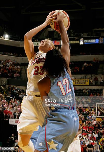 Katie Douglas of the Indiana Fever battles Ivory Latta of the Atlanta Dream at Conseco Fieldhouse on August 30 2008 in Indianapolis Indiana NOTE TO...