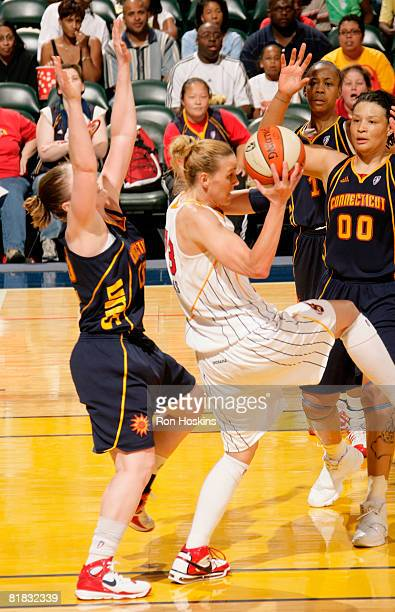 Katie Douglas of the Indiana Fever battles Tamika Whitmore and Lindsay Whalen of the Connecticut Sun at Conseco Fieldhouse on July 5 2008 in...