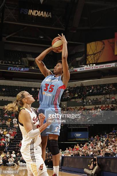 Katie Douglas of the Indiana Fever defends Angel McCoughtry of the Atlanta Dream during Game One of the East Conference SemiFinals at Banker's Life...