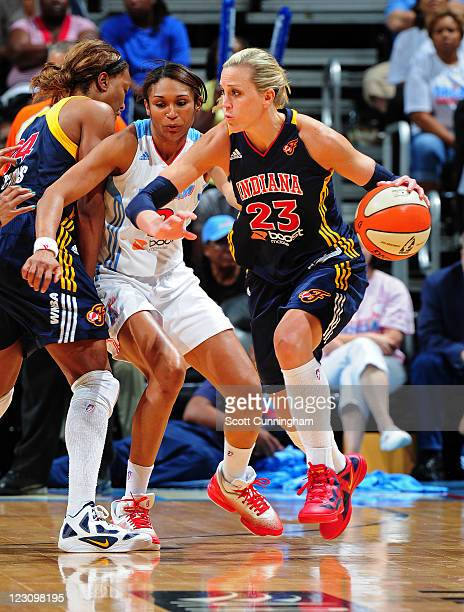 Katie Douglas of the Indiana Fever drives against Iziane Castro Marques of the Atlanta Dream at Philips Arena on August 30 2011 in Atlanta Georgia...