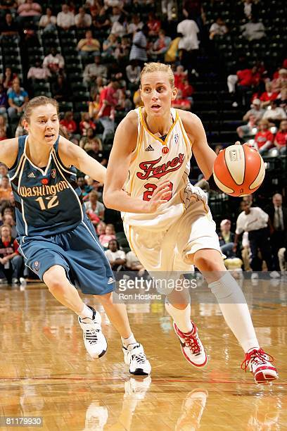 Katie Douglas of the Indiana Fever drives to the basket trailed by Laurie Koehn of the Washington Mystics during the WNBA game on May 17 2008 at...
