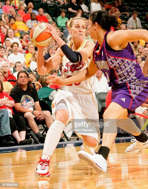 Katie Douglas of the Indiana Fever looks to score on Kara Lawson of the Sacramento Monarchs at Conseco Fieldhouse June 24 2008 in Indianapolis...
