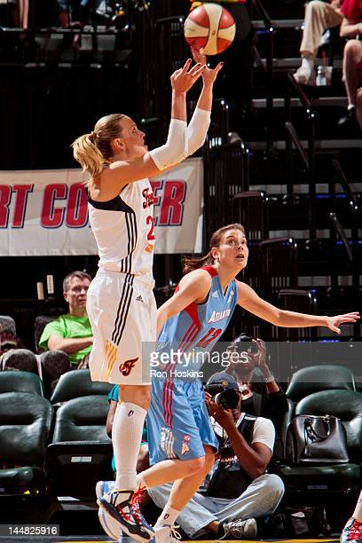Katie Douglas of the Indiana Fever shoots against Laurie Koehn of the Atlanta Dream at Bankers Life Fieldhouse on May 19 2012 in Indianapolis Indiana...