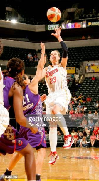 Katie Douglas of the Indiana Fever shoots over Ticha Penicheiro the Sacramento Monarchs at Conseco Fieldhouse June 24 2008 in Indianapolis Indiana...