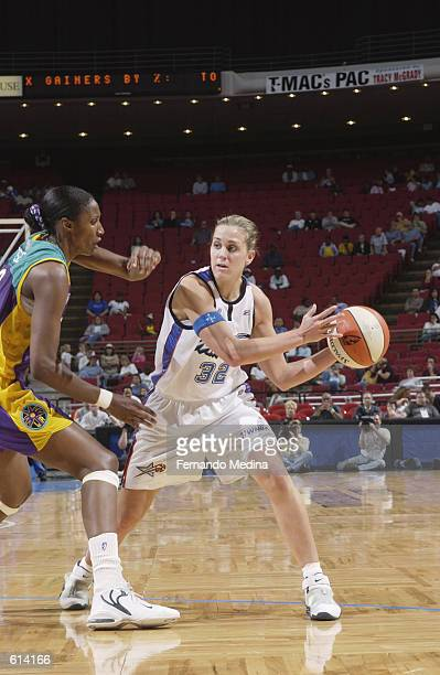 Katie Douglas of the Orlando Miracle passes around Lisa Leslie of the Los Angeles Sparks during the WNBA game at TD Waterhouse Centre in Orlando...