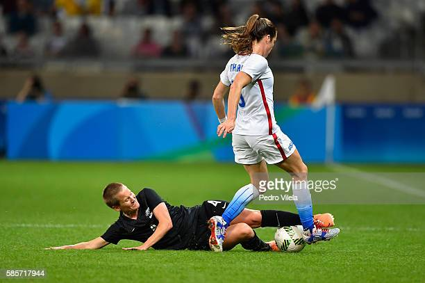 Katie Duncan of New Zealand goes up against Kelley O'Hara of United States in the Women's Group G first round match between the United States and New...