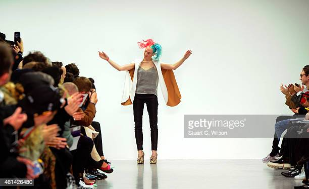 Katie Eary appears on the runway after her show at the London Collections Men AW15 at Victoria House on January 12 2015 in London England