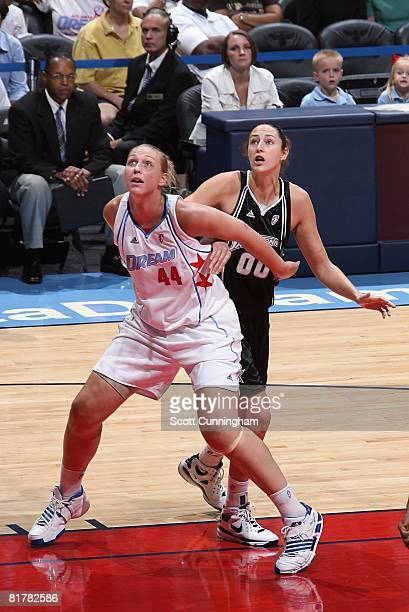 Katie Feenstra of the Atlanta Dream battles for rebounding position against Ruth Riley of the San Antonio Silver Stars during the WNBA game on June...