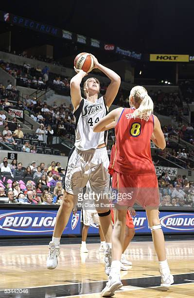 Katie Feenstra of the San Antonio Silver Stars shoots against Maria Stepanova of the Phoenix Mercury during the WNBA game on July 23 2005 at SBC...