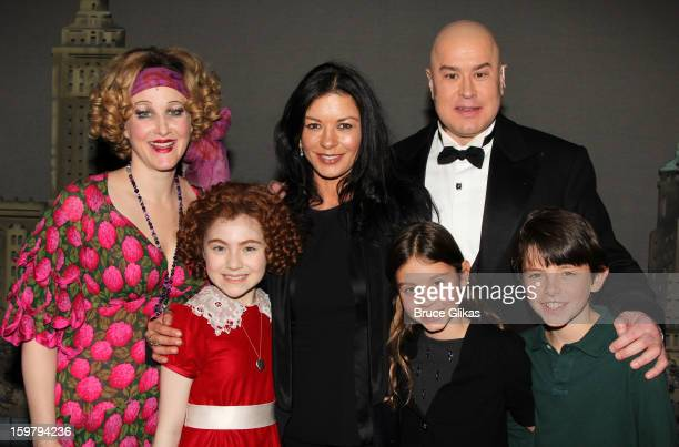 Katie Finneran as Miss Hannigan Lilla Crawford as Annie Catherine Zeta Jones Carys Douglas Merwin Foard as Daddy Warbucks and Dylan Douglas pose...