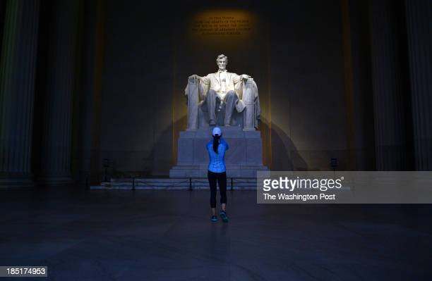 Katie Frisbie takes a photograph of the Lincoln memorial which reopened following the end of the government shutdown 'I have never seen the memorial...